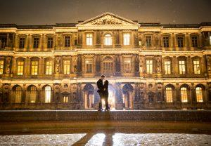 best photo spot in the Louvre Paris couple holding each other at night under the rain