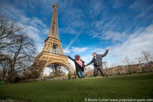 jumping couple in front of the Eiffel Tower Paris